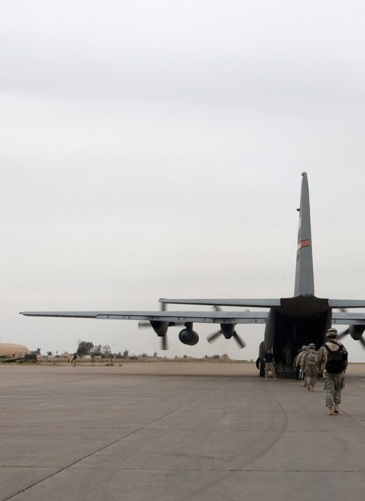 A soldier loads up onto an American plane near Mosul, Iraq.